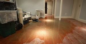 Water Damage Due To Flooded Bathroom