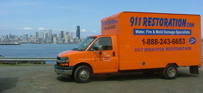 Water Damage Restoration Truck Driving To Job Site