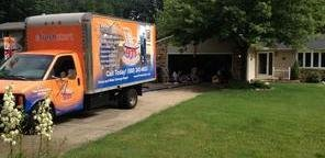 Water and Mold Damage Restoration Truck Parked Near Lawn